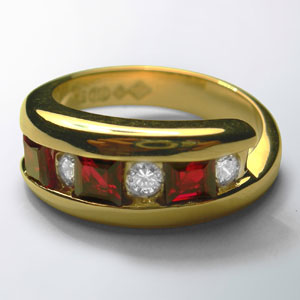 18ct-Yellow-Gold-engagement-ring-with-Princess-cut-African-Rubies